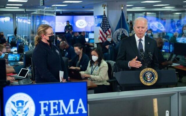 US President Joe Biden speaks about Hurricane Ida alongside FEMA Administrator Deanne Criswell (L) during a visit to FEMA Headquarters in Washington, DC, August 29, 2021. (Photo by SAUL LOEB / AFP)