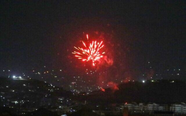 Celebratory fireworks  light up part of the night sky after the last US aircraft took off from the airport in Kabul early on August 31, 2021. (Photo by AFP)