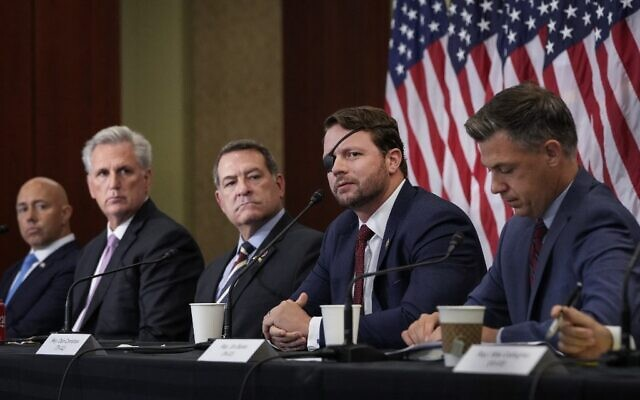 (L-R) Rep. Brian Mast (R-FL), House Minority Leader Kevin McCarthy (R-CA), Rep. Mark Green (R-TN) Rep. Dan Crenshaw (R-TX) and Rep. Jim Banks (R-IN) listen during a meeting with House Republicans, including those who served in the military, about the American military withdrawal in Afghanistan at the U.S. Capitol on August 30, 2021 in Washington, DC. (Drew Angerer / GETTY IMAGES NORTH AMERICA / Getty Images via AFP)