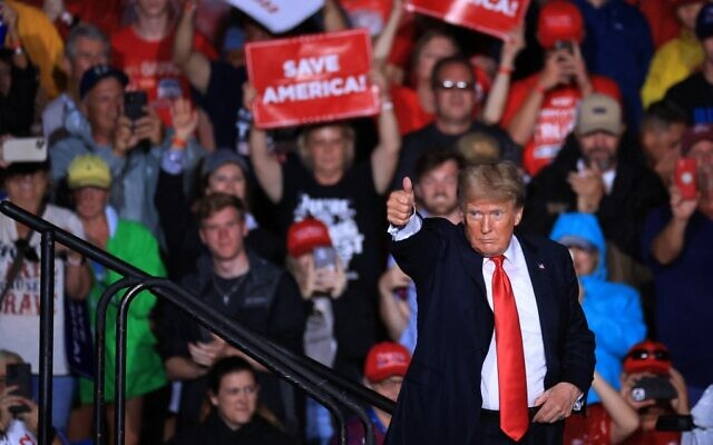 """Former US president Donald Trump gives a thumbs-up as he finishes addressing a """"Save America"""" rally at York Family Farms on August 21, 2021 in Cullman, Alabama. (Chip Somodevilla/Getty Images/AFP)"""