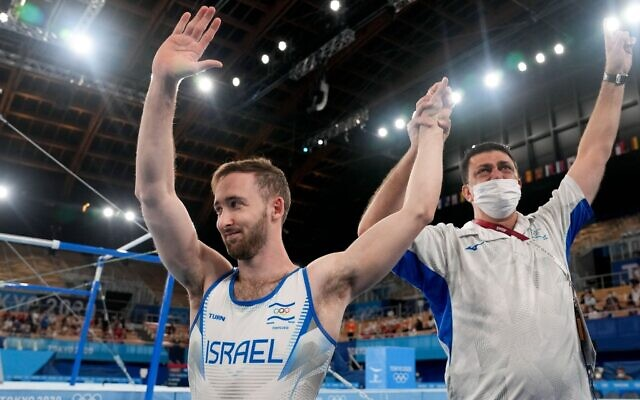 Artem Dolgopyat of Israel, left, celebrates after winning the gold medal on the floor exercise during the artistic gymnastics men's apparatus final at the 2020 Summer Olympics, August 1, 2021, in Tokyo. (AP Photo/Natacha Pisarenko)