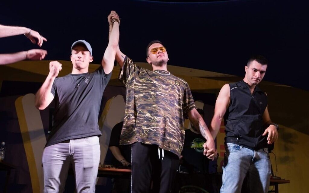Itamar Barry, aka DeMellow, left, is declared winner of the 2019 Israeli beatbox championship in this undated photo. (Courtesy Israel Beatbox)