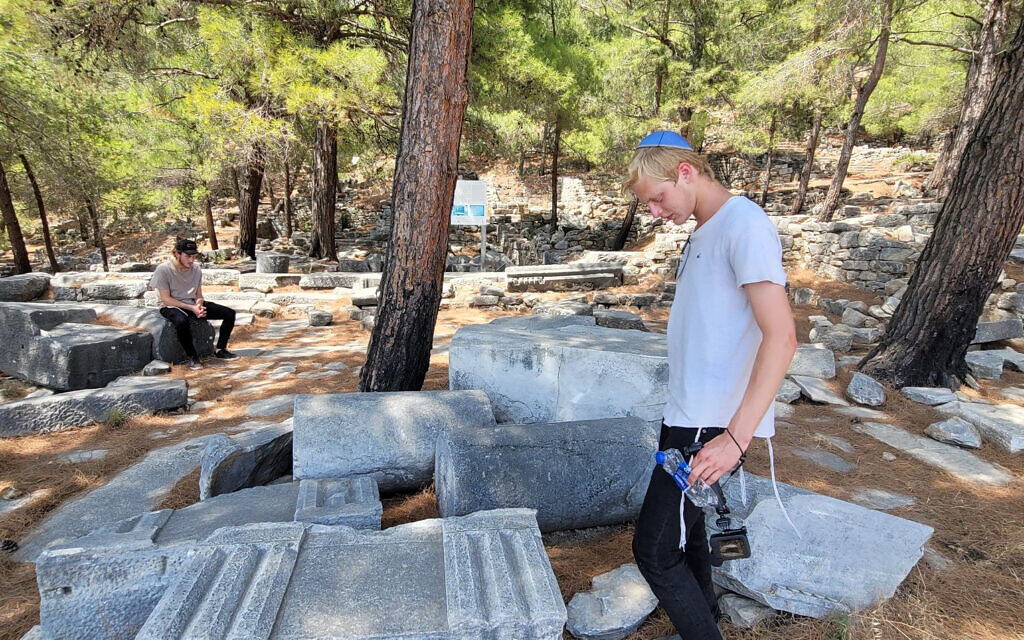 Chaim Chitrik, left, and his friend Eliezer inspect the ruins of the synagogue of Priene, Turkey, on August 1 (Mendy Chitrik/via JTA)