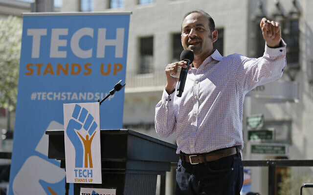 Dilawar Syed, president of the software company Freshdesk, speaks during a Tech Stands Up rally on Pi Day, March 14, 2017, outside City Hall in Palo Alto, California (AP Photo/Eric Risberg)
