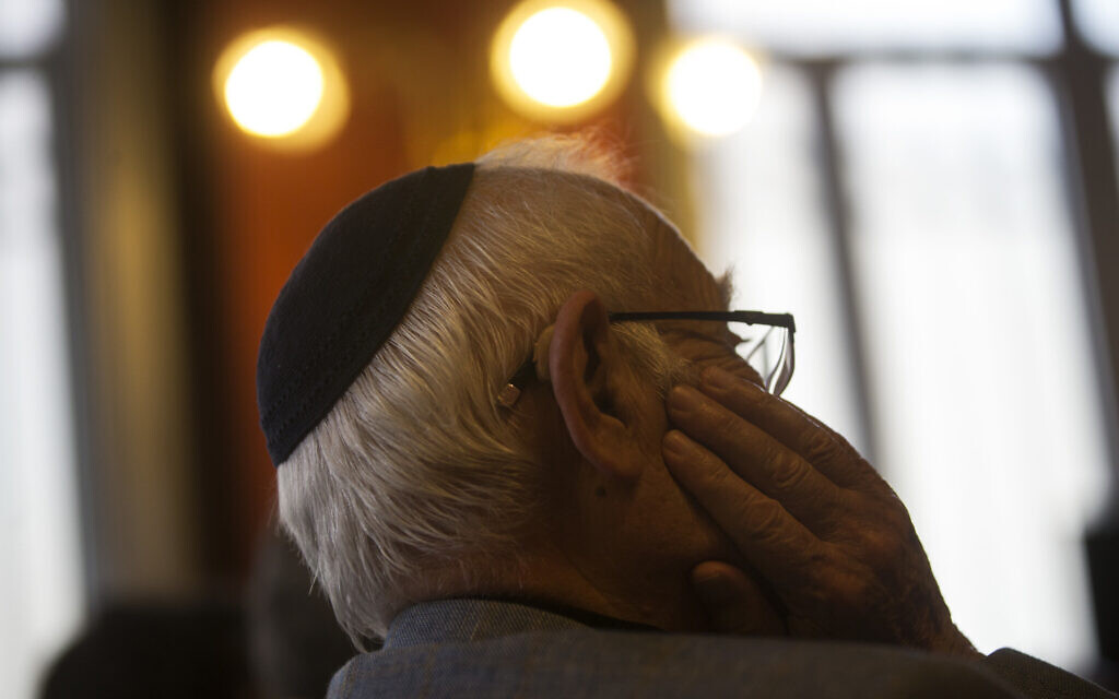 Illustrative: A man wearing a kippah listens during a news conference at the Royal Spanish Academy in Madrid, February 20, 2018. (AP Photo/Francisco Seco)
