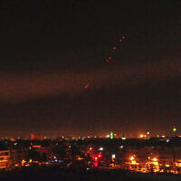 Illustrative: This photo released by the Syrian official news agency SANA shows anti-aircraft fire in the sky after US-led airstrikes targeting different parts of the Syrian capital Damascus in retaliation for the country's alleged use of chemical weapons early Saturday, April 14, 2018. Syrian air defenses responded to the joint strikes by the United States, France and Britain. (SANA via AP)