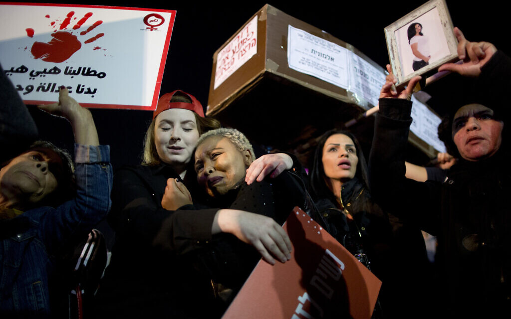 Illustrative: a protest against violence against women in Tel Aviv, December 4, 2018. (AP Photo/Oded Balilty)