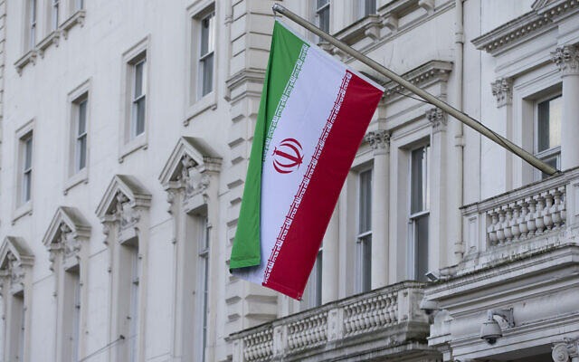 The flag of the Islamic Republic of Iran flies outside its embassy in London, February 2014. (AP Photo/Alastair Grant)