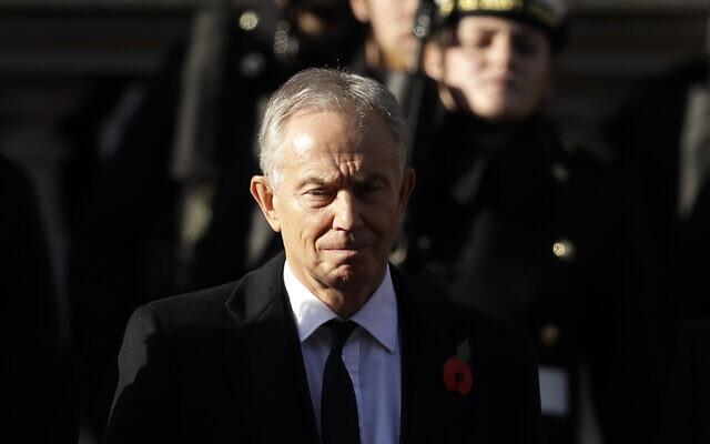 Former British prime minister Tony Blair attends the Remembrance Sunday ceremony at the Cenotaph in Whitehall in London, November 10, 2019. (AP Photo/Matt Dunham)