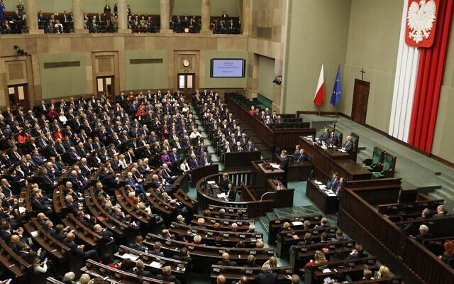 File: The lower hose of Poland's parliament, or Sejm, filled with new lawmakers, and foreign diplomats as guests, during the gala inauguration of a new four-year term of the national parliamentin Warsaw, Poland, Tuesday, Nov. 12, 2019. (AP Photo/Czarek Sokolowski)