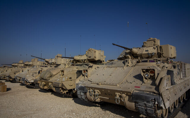 Bradley fighting vehicles are parked at a US military base at an undisclosed location in northeastern Syria, on November 11, 2019. (AP Photo/Darko Bandic)