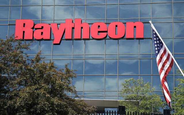 An American flag flies in front of the facade of Raytheon's Integrated Defense Systems facility, in Woburn, Mass, on June 10, 2019. (AP Photo/Elise Amendola, File)