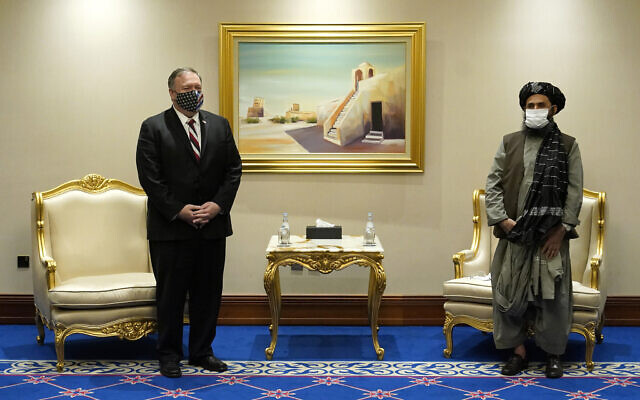 Secretary of State Mike Pompeo meets with Mullah Abdul Ghani Baradar, head of the Taliban's peace negotiation team, amid talks between the Taliban and the Afghan government, Nov. 21, 2020, in Doha, Qatar. (AP/Patrick Semansky, Pool)
