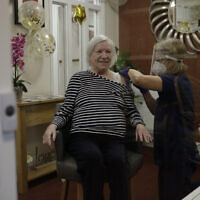 Care home resident Gwen Nurse, aged 86 receives her first dose of the Oxford/AstraZeneca COVID-19 vaccine in south west London, Jan. 13, 2021  (AP Photo/Matt Dunham)