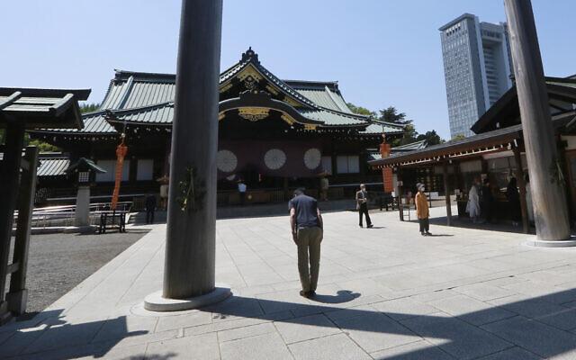 Illustrative -- A worshipper bows at Yasukuni Shrine in Tokyo, April 21, 2021  (AP Photo/Koji Sasahara)