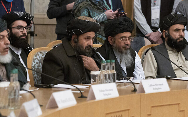 In this March 18, 2021, photo, Taliban co-founder Mullah Abdul Ghani Baradar, center, with other members of the Taliban delegation, attends an international peace conference in Moscow, Russia. (AP Photo/Alexander Zemlianichenko, Pool, File)