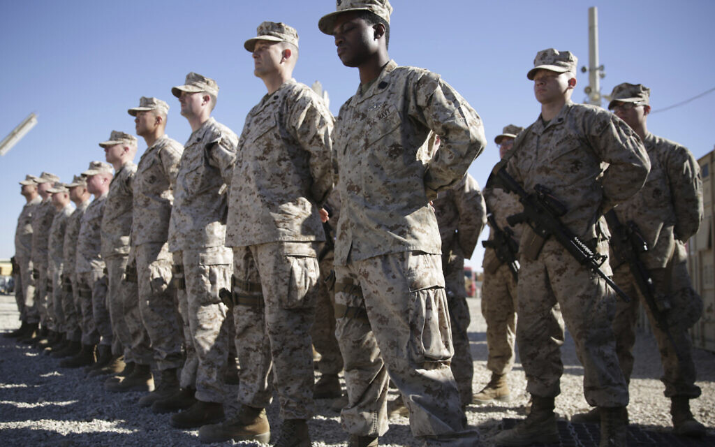 In this Jan. 15, 2018, file photo, US Marines watch during the change of command ceremony at Task Force Southwest military field in Shorab military camp of Helmand province, Afghanistan. (AP Photo/Massoud Hossaini, File)