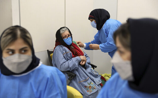 A woman receives the Sinopharm COVID-19 vaccine at the Iran Mall shopping center in Tehran, Iran, Monday, May 17, 2021. (AP/Ebrahim Noroozi)