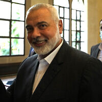 Hamas leader Ismail Haniyeh flashes the victory sign before he speaks to journalists after his meeting with Lebanese Parliament Speaker Nabih Berri, in Beirut, Lebanon, June 28, 2021. (AP Photo/Hassan Ammar)