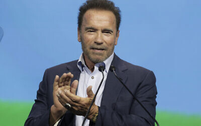 Arnold Schwarzenegger talks on stage about his dreams and actions to fight the climate crisis in Vienna, Austria, Thursday, July 1, 2021. (AP/Lisa Leutner)