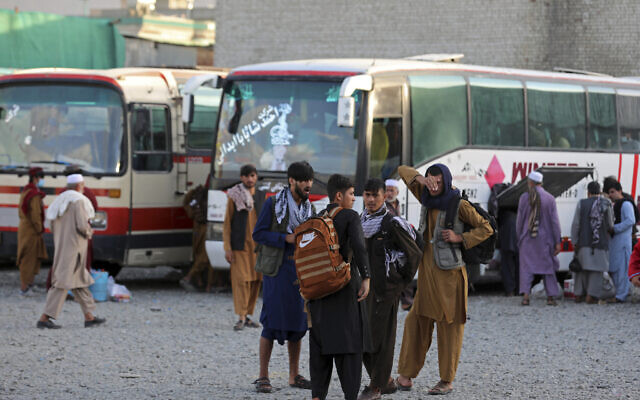 Illustrative: Afghans wait to board a bus to travel to Iran, in Kabul, Afghanistan, June 30, 2021. (AP/Rahmat Gul)