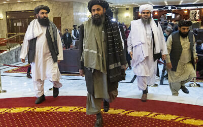 Taliban co-founder Mullah Abdul Ghani Baradar, center, arrives with other members of the Taliban delegation for an international peace conference in Moscow, Russia, on March 18, 2021. (AP/Alexander Zemlianichenko, Pool, File)