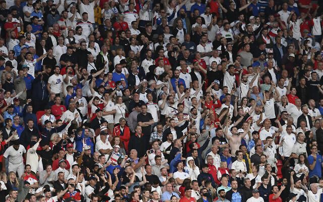 England fans cheer during the Euro 2020 final soccer match between Italy and England at Wembley stadium in London, July 11, 2021. (Facundo Arrizabalaga/Pool via AP)