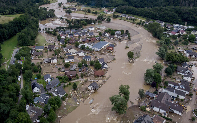 The Ahr river floats past destroyed houses in Insul, Germany, July 15, 2021. (Michael Probst/AP)