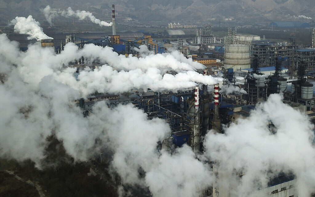 In this Nov. 28, 2019, file photo, smoke and steam rise from a coal processing plant in Hejin in central China's Shanxi Province. (AP Photo/Sam McNeil, File)