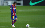 In this file photo dated Thursday, April 29, 2021, Barcelona's Lionel Messi reacts during the Spanish La Liga match against Granada at the Camp Nou stadium in Barcelona, Spain. (AP/Joan Monfort)