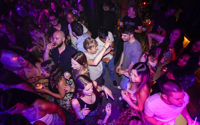 In this Monday, July 19, 2021 file photo, people drink on the dance floor shortly after the reopening, at The Piano Works in Farringdon, in London. European nations, across the board, have made strides in their vaccination rates in recent months, with or without incentives. (AP Photo/Alberto Pezzali, File)