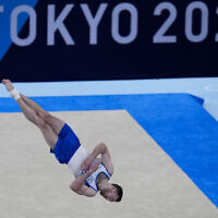 Artem Dolgopyat of Israel performs on the floor exercise during the artistic gymnastics men's apparatus final at the 2020 Summer Olympics, August, 2021, in Tokyo. (AP Photo/Gregory Bull)