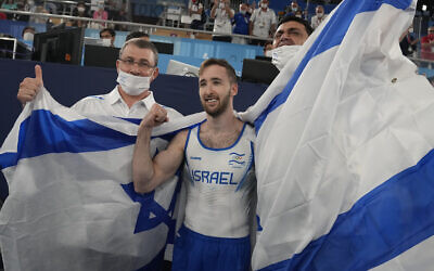 Artem Dolgopyat of Israel celebrates after winning the gold medal on the floor exercise in the artistic gymnastics men's final at the 2020 Summer Olympics, Sunday, Aug. 1, 2021, in Tokyo. (AP Photo/Natacha Pisarenko)