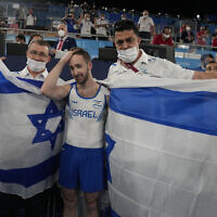 Artem Dolgopyat of Israel celebrates after winning the gold medal on the floor exercise during the artistic gymnastics men's apparatus final at the 2020 Summer Olympics, August 1, 2021, in Tokyo. (AP Photo/Natacha Pisarenko)