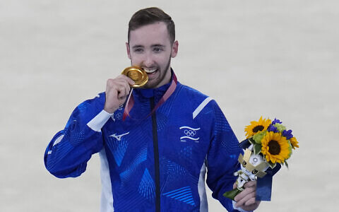 Artem Dolgopyat of Israel poses after winning the gold medal on the floor exercise during the artistic gymnastics men's apparatus final at the 2020 Summer Olympics, August 1, 2021, in Tokyo, Japan. (AP Photo/Gregory Bull)
