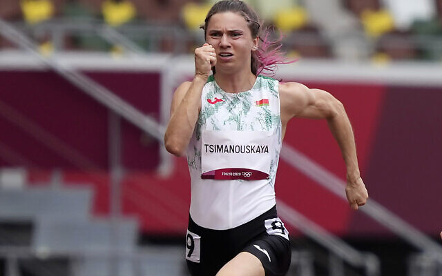 Krystsina Tsimanouskaya, of Belarus, runs in the women's 100-meter run at the 2020 Summer Olympics, July 30, 2021. (AP/Martin Meissner)