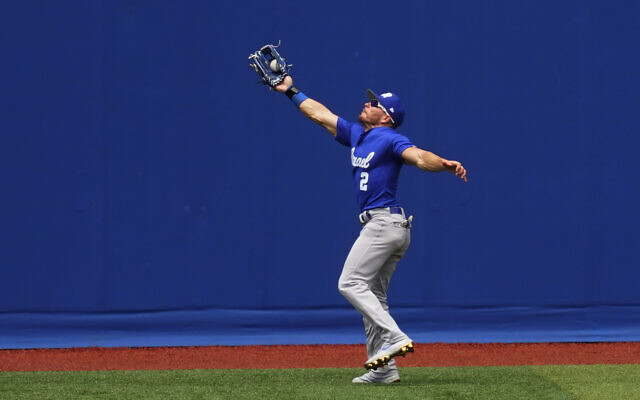 Israel's Blake Gailen catches a sacrifice fly during a baseball game against South Korea at Yokohama Baseball Stadium during the 2020 Summer Olympics, in Yokohama, Japan, August 2, 2021. (Matt Slocum/AP)