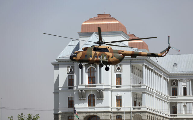 Illustrative: A helicopter carrying President Ashraf Ghani prepares to land at the Darul Aman Palace in Kabul, Afghanistan, August 2, 2021. (AP/Rahmat Gul)