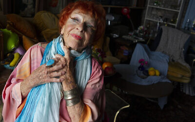 Artist and performer Ilona Royce Smithkin poses in her house in Provincetown, Massachusetts, July 20, 2012. (AP Photo/Virginia Mayo)