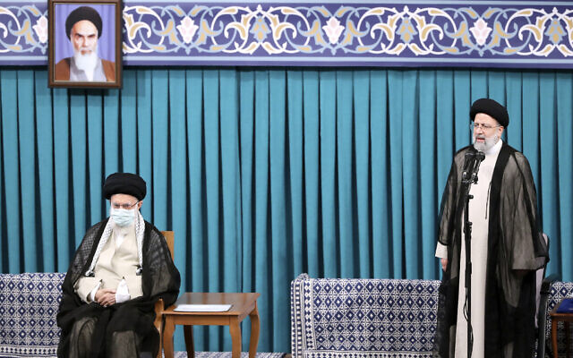 Newly elected Iranian President Ebrahim Raisi, right, speaks after receiving official seal of approval of Supreme Leader Ayatollah Ali Khamenei, left, in an endorsement ceremony in Tehran, Iran, August 3, 2021. (Office of the Iranian Supreme Leader via AP)