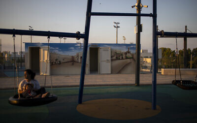 The doors of bomb shelters are open in a public park in Sderot on July 28, 2021. (AP Photo/Ariel Schalit)