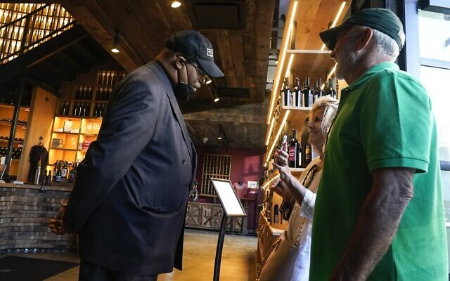Security personnel ask customers for proof of vaccination as they enter City Winery, June 24, 2021, in New York. (AP Photo/Frank Franklin II, File)