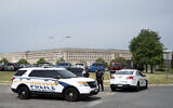 Police block off an entrance to the Pentagon following reports of multiple gun shots fired on a bus platform near the facility's Metro station, August 3 2021, in Washington. (AP Photo/Kevin Wolf)