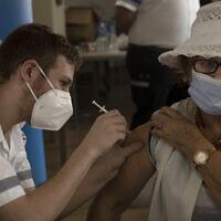 An Israeli woman receives a third coronavirus vaccine injection at a senior center in Jerusalem, on Wednesday, August 4, 2021. (AP Photo/Maya Alleruzzo)