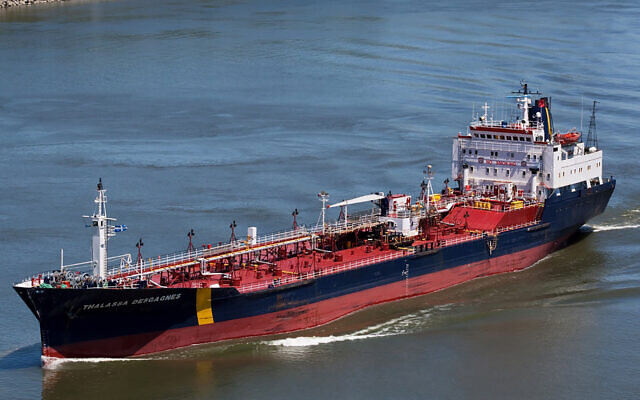 In this June 14, 2012 photo, the ship that would later become the Asphalt Princess sails through Quebec City, Canada. (Steve Geronazzo via AP)