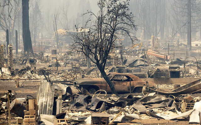 Homes and cars destroyed by the Dixie Fire line central Greenville on  Aug. 5, 2021, in Plumas County, Calif. (AP Photo/Noah Berger)
