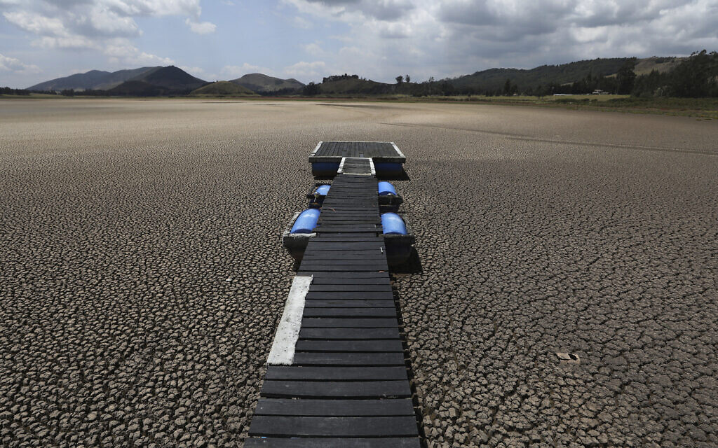 In this Feb. 17, 2021 file photo, a floating dock sits on the lakebed of the Suesca lagoon, in Suesca, Colombia (AP Photo/Fernando Vergara, File)