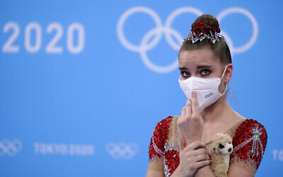 Dina Averina, of the Russian Olympic Committee, waits for her final score after competing in the individual all-around rhythmic gymnastics final at the 2020 Summer Olympics, on Saturday, August 7, 2021, in Tokyo, Japan. Averina won the silver medal in the event. (AP/Ashley Landis)