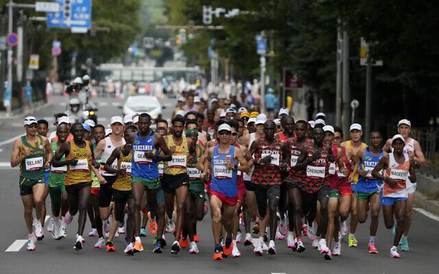 Runners compete during the men's marathon at the 2020 Summer Olympics on Aug. 8, 2021, in Sapporo, Japan. (AP/Shuji Kajiyama)