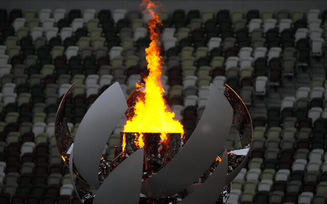 The Olympic flame burns prior to the closing ceremony in the Olympic Stadium at the 2020 Summer Olympics, August 8, 2021, in Tokyo, Japan. (AP Photo/Aaron Favila)
